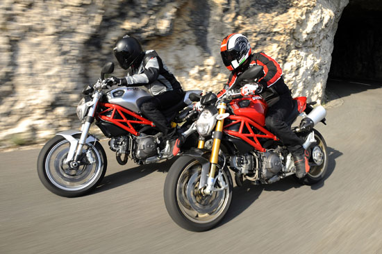 2009 Ducati Monster 1100 (silver) and Monster 1100S (red)