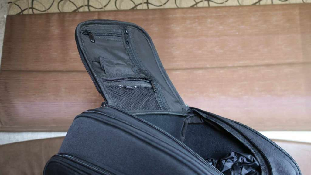 The lid of the Viking Sport Tail Bag is shown, displaying the office organizer on the underside. Zippered pockets and a mesh pouch are prominent.
