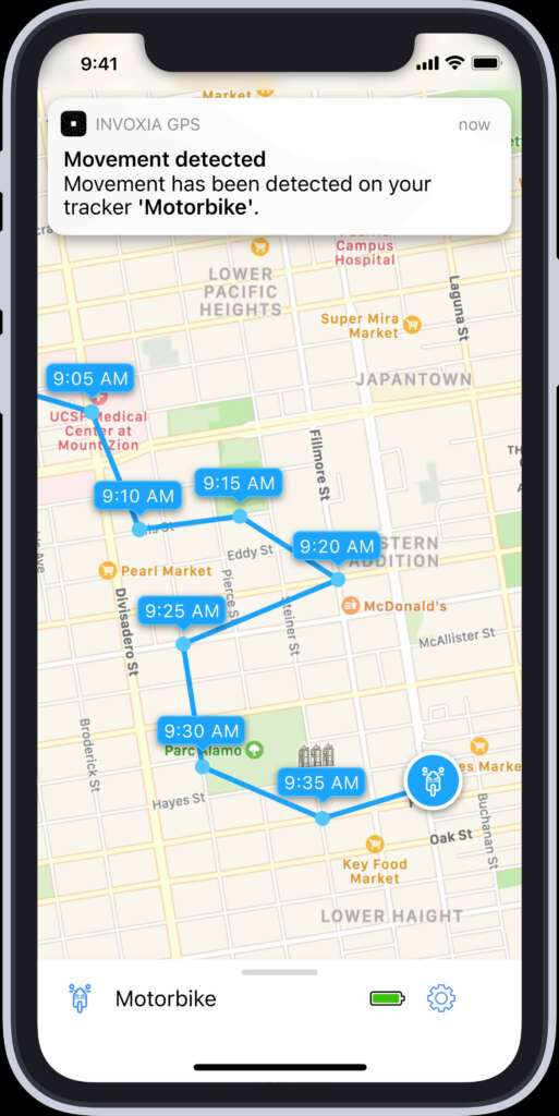 Map view of the Invoxia GPS app, showing multiple location tags in blue over a Google Maps image.